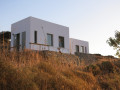 exterior view of a white summer house on a greek island